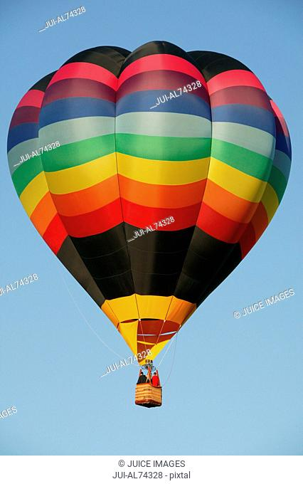 View of a colorful hot-air balloon against blue sky, Balloon Festival, Albuquerque, New Mexico, USA