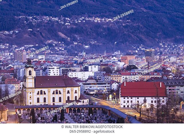 Austria, Tyrol, Innsbruck, elevated view of the Wilten Basilica, dawn, winter