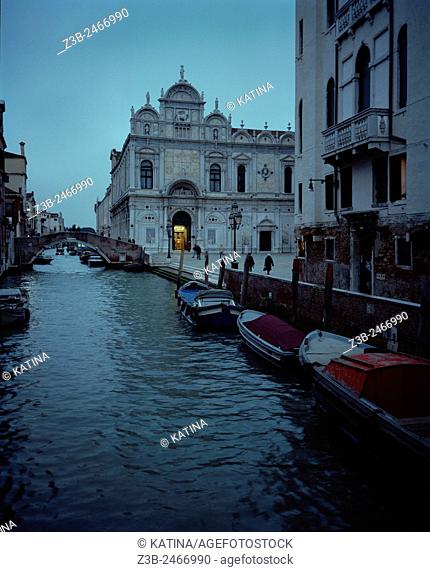 Venetian canal at dusk and the Scuola Grande di San Marco Hospital in the Castello district of Venice, Italy, Europe