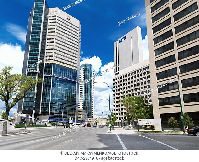 Winnipeg downtown city street scenery with high-rise buildings of Artis and MTS. Main street, Winnipeg, Manitoba, Canada 2017