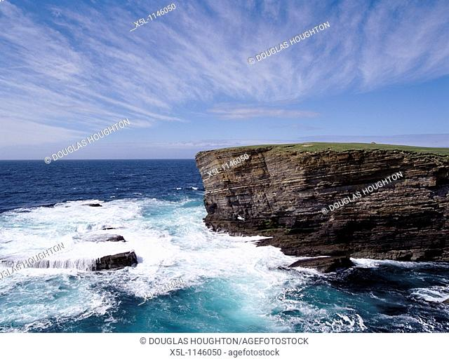 Brough of Bigging YESNABY ORKNEY Sea waves rough seas blue sky cliffs coast