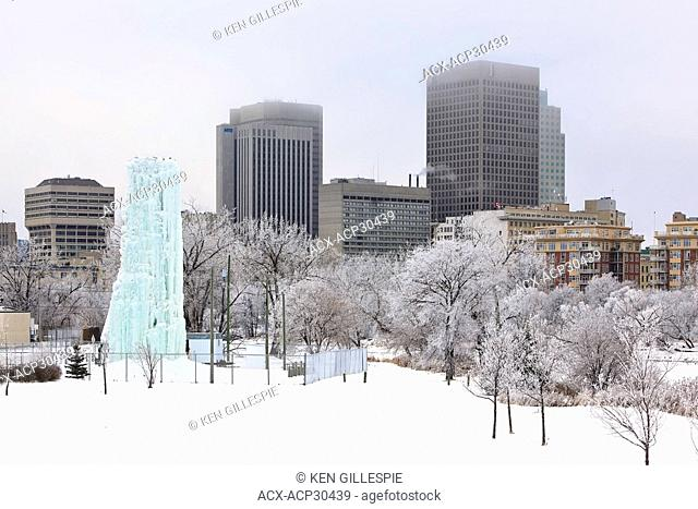 Downtown Winnipeg skyline on a frosty winter day. Ice climbing tower in the foreground. Winnipeg, Manitoba, Canada