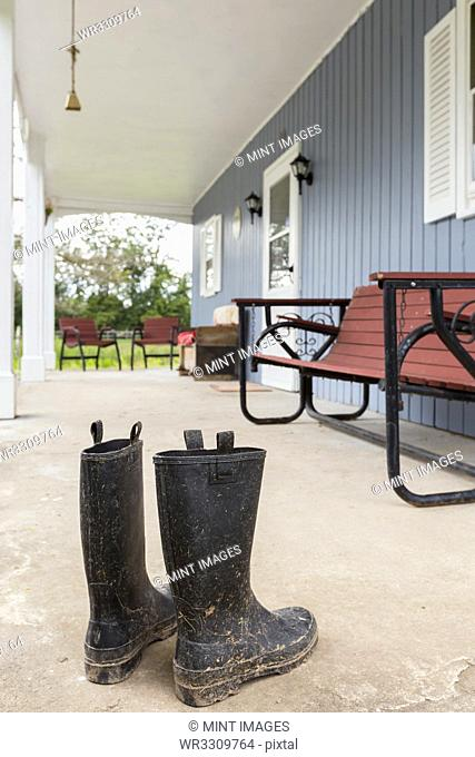 Dirty wellingtons on front porch