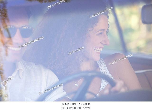 Couple enjoying car ride together on sunny day