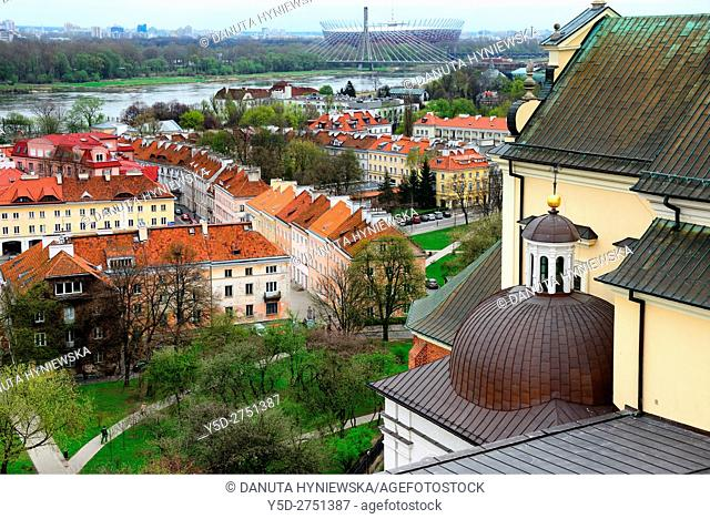 on right Kosciol Akademicki Sw. Anny - St Anne's Church at Castle Square, view for Mariensztat - smallest district of Warsaw located between the Vistula river...