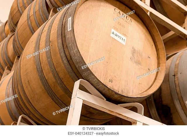 Close up of stacks of wine barrels