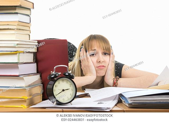 Student bored and tired of doing the preparation for exams