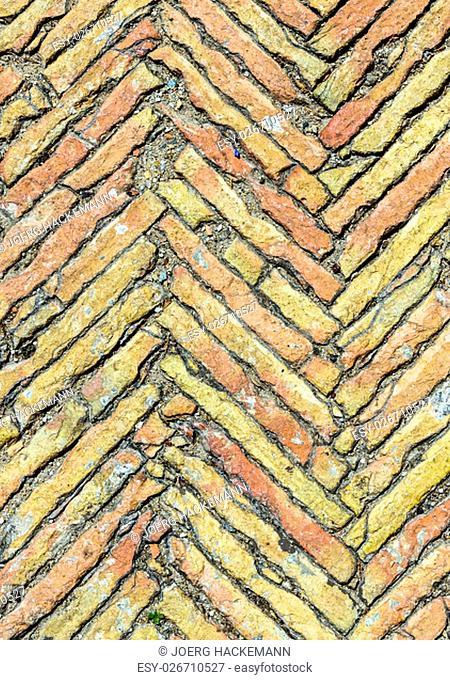 Broken brown brick floor in red colors
