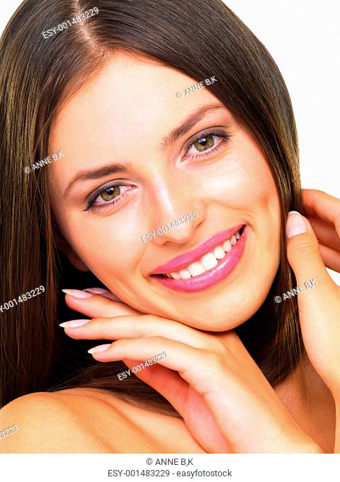 Closeup of beautiful woman with stunning looks over white background