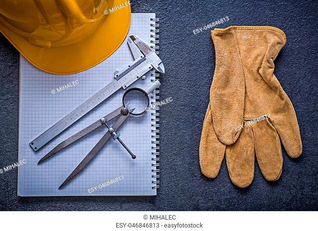 Copybook hard hat divider slide caliper safety gloves construction concept