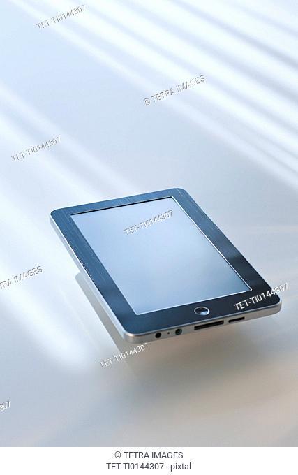 Digital tablet reflecting light