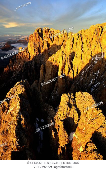 Aerial shot of Sassolungo and Sassopiatto at sunset. Sella Group Val Gardena. Dolomites Trentino Alto Adige Italy Europe