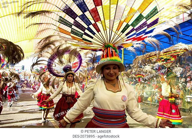 Suri Sicuri Dancers Wearing Elaborate Feather Headdress In The Procession Of The Carnaval De Oruro, Oruro, Bolivia
