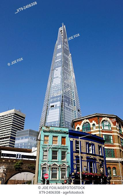 the shard building towering over local buildings in southwark London England UK