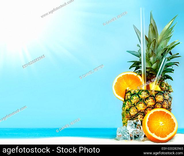 Fresh pineapple with oranges and tubules