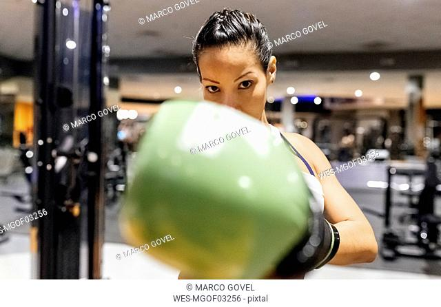 Woman practicing boxing in the gym