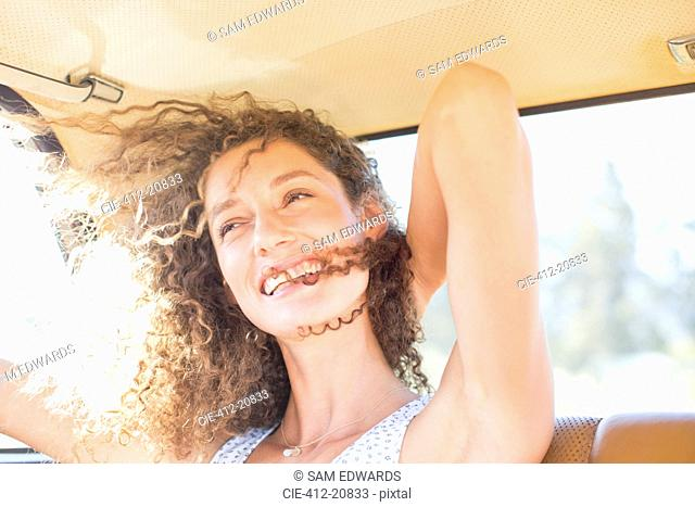 Woman being windswept from window breeze