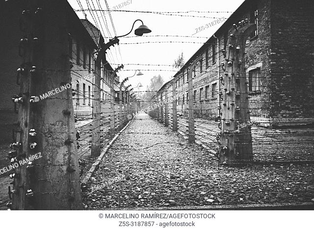 Auschwitz Nazi concentration and extermination camp. Electrified fences separating barracks. Auschwitz, German-occupied, Poland, Europe