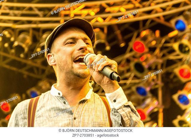 "Kiel, Germany - June 24th 2016: Classic-Open-Air-Concert """"Soul meets Classic"""" with Max Mutzke, Alexandra Korolliuk, Philharmonic Orchestra Kiel and GMD Georg..."