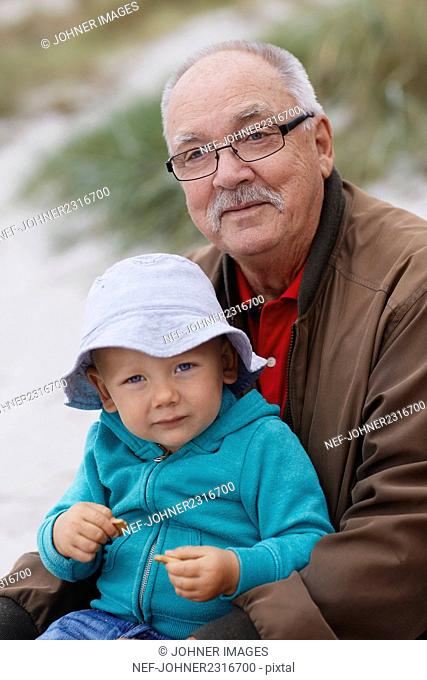 Portrait of grandfather with grandson