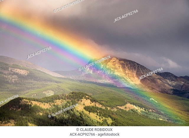 Rainbow in the mountains in Jasper National Park, Alberta, Canada
