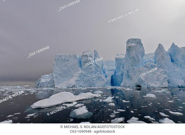View of tidewater glacier caves found deep inside Neko Harbor on the western side of the Antarctic Peninsula, Southern Ocean