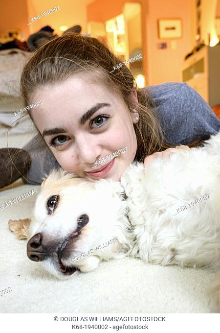 Teenage girl with her dog, a cocker spaniel