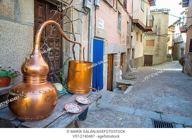 Wine-making utensils and street. Miranda del Castañar, Sierra de Francia Nature Reserve, Salamanca province, Castilla Leon, Spain