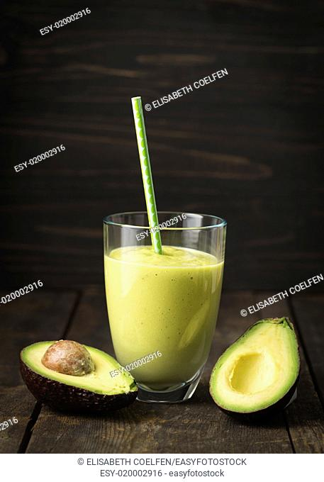 Healthy green smoothie with avocado in a glass