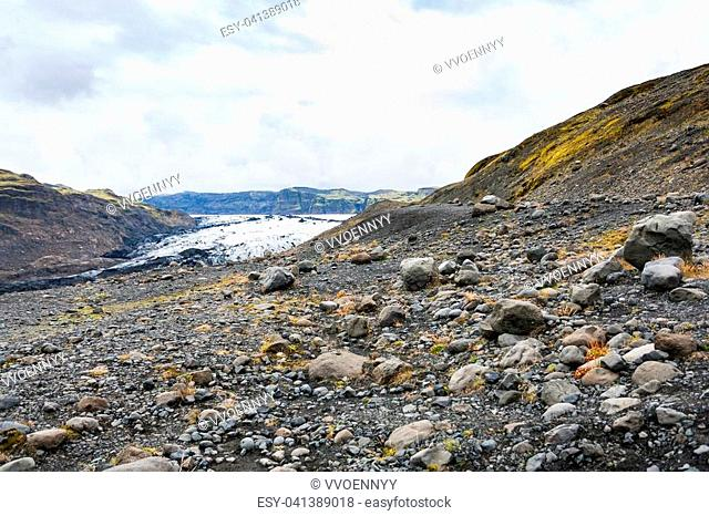 travel to Iceland - volcanic valley and Solheimajokull glacier (South glacial tongue of Myrdalsjokull ice cap) in Katla Geopark on Icelandic Atlantic South...