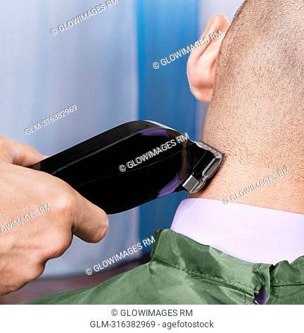 Man receiving a haircut in a salon