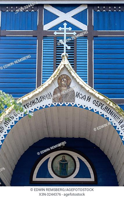 Front archway with Russian writing around it leading into blue Russian Orthodox Church in the 'Land of the Open Shutters, ' Puchly, Poland