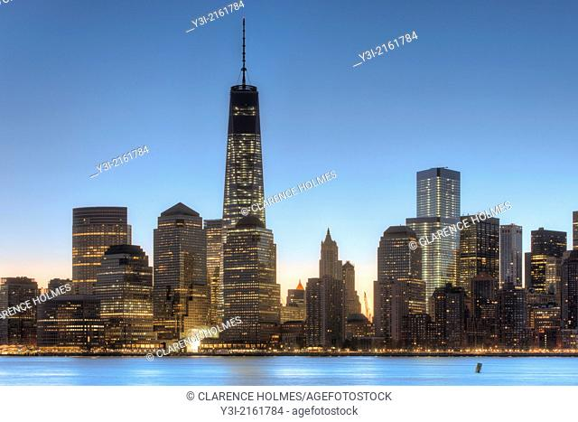 The Freedom Tower 1 World Trade Center and other buildings of the lower Manhattan skyline are illuminated as the sky brightens shortly before sunrise in New...