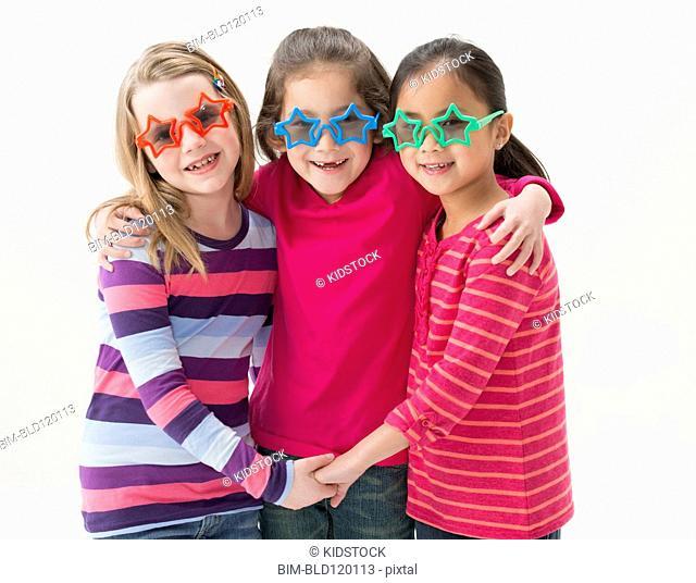 Girls wearing star-shape sunglasses