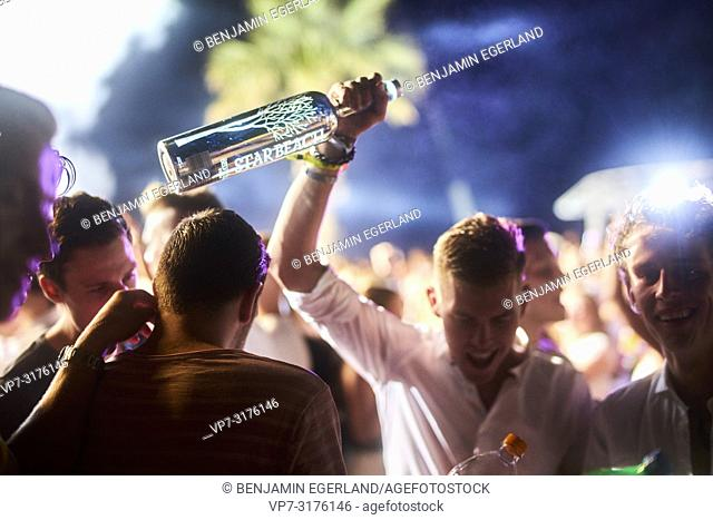 party people holding Belvedere Vodka bottle at music festival Starbeach Chersonissos, Crete, Greece, at 06. August 2018
