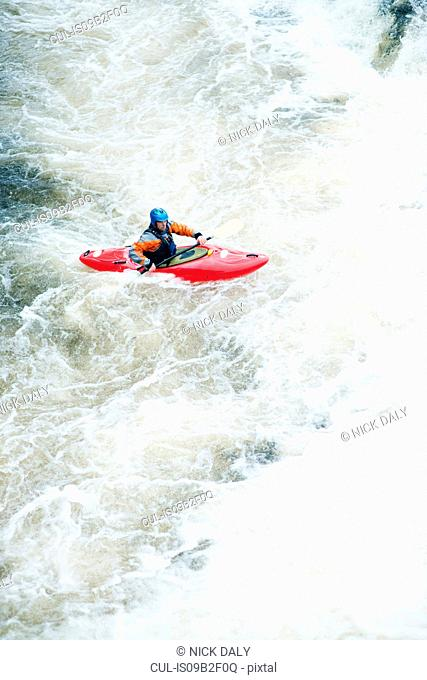 High angle view of male kayaker paddling River Dee white water rapids, Llangollen, North Wales