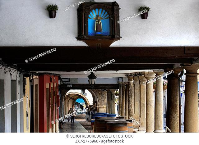 Arcades and columns in Galiana street in the famous ancient city of Aviles, Asturias, Spain. One of the stops of the Transcantabrico Gran Lujo luxury train