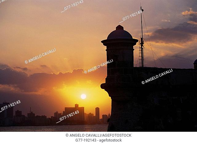 Fortress of El Morro at sunset and Havana in background. Cuba