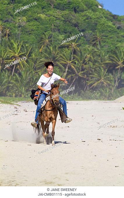 Colombia, Magdalena, Park Nacional Natural Tayrona, Arrecifes, Tourist riding horse