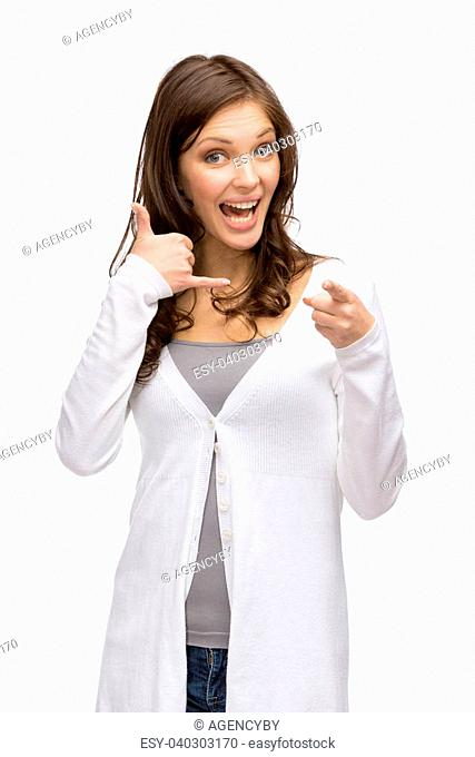 Half-length portrait of woman phone gesturing who points with finger at you, isolated on white. Concept of communication and contact