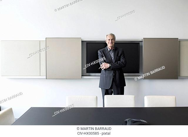 Portrait confident senior businessman in conference room
