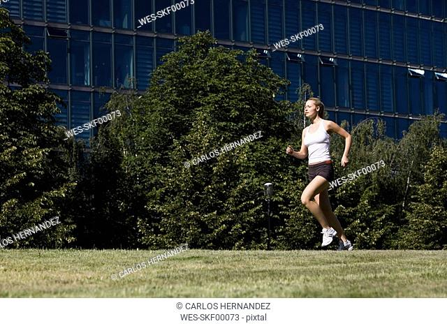 Germany, Berlin, Young woman jogging