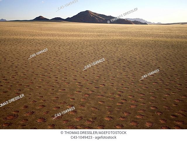 Namibia - Aerial view of grass-grown desert plain and isolated mountain ridges at the edge of the Namib Desert  In March during the rainy season with a delicate...