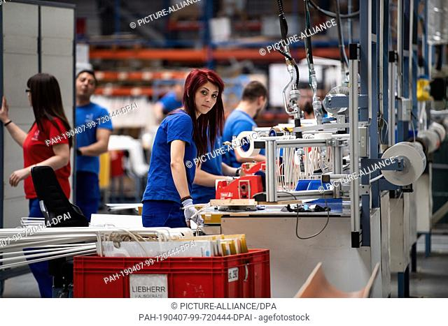 05 April 2019, Bulgaria, Radinowo: Employees manufacture refrigerators at the Liebherr Marica EOOD household appliances headquarters in Radinowo near Plovdiv
