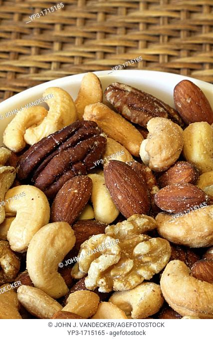 A bowl of mixed nuts: Cashews, almonds, pecans and walnuts