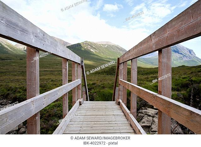 Wooden bridge over Allt Dearg Mor with a view towards Glen Sligachan, Isle of Skye, Scotland, United Kingdom