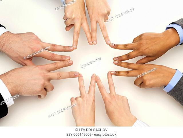 business and succcess concept - group of businesspeople showing v-sign