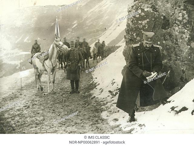 Soldiers and horses marching on snowy mountain trail