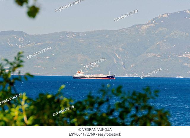 Cargo ship near mountain coast