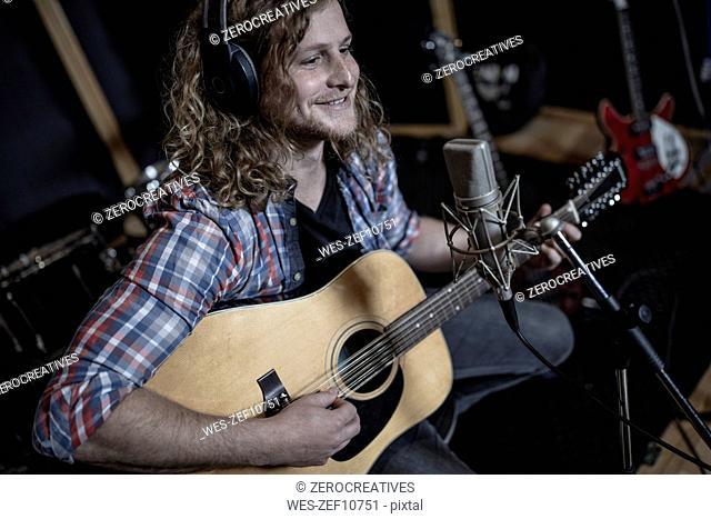 Guitarist at recording studio